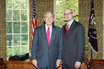 President George W. Bush congratulates Arizona?s 2008 State Teacher of the Year, Robert Kelty, in the Oval Office on Wednesday, April 30, 2008. Mr. Kelty is a teacher at Puente de Hozho Elementary School in Flagstaff, AZ.
