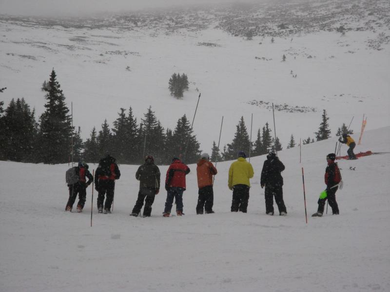 The Arizona Snow Bowl ski patrol practices an avalanche simulation drill.