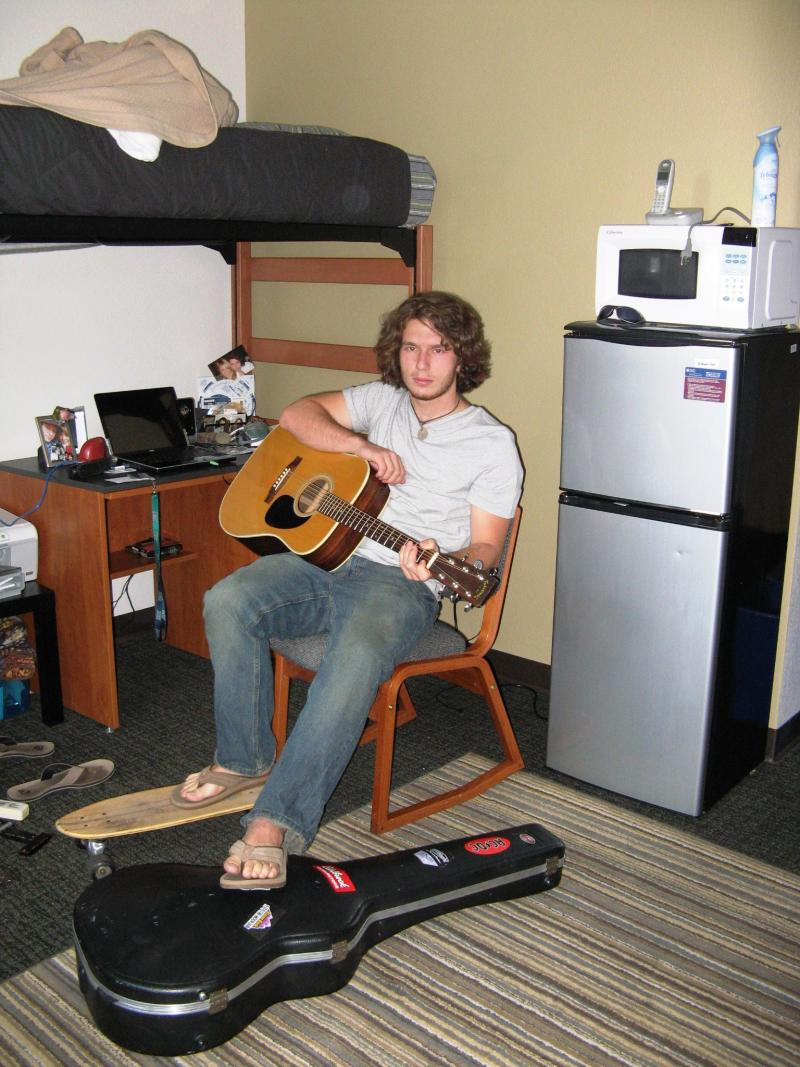 NAU student Kyle Beloin relaxes in his dorm room between classes.