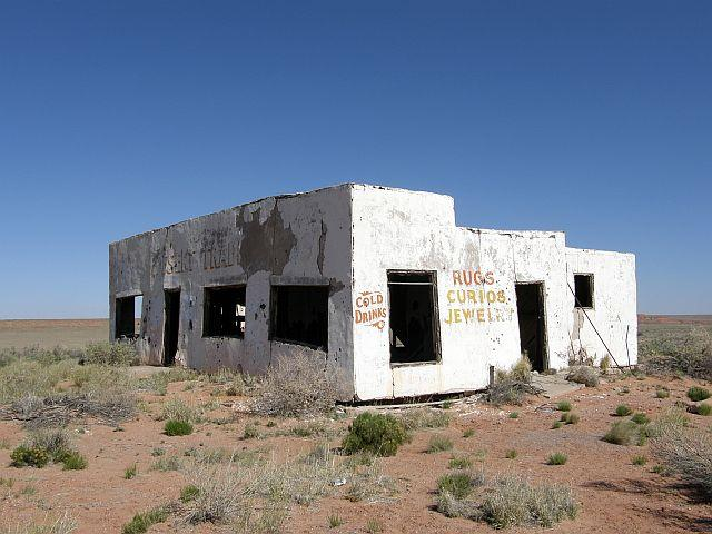 The ghostly remnants of the Painted Desert Trading Post stand as a silent guardian on a forgotten alignment of Route 66.
