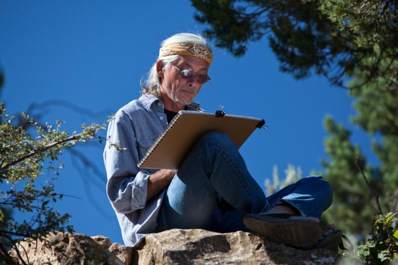 Bruce Aiken sketching Isis Temple along the rim of the Grand Canyon