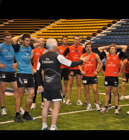 Collingwood Magpies' coach Mick Malthouse refocuses the troops halfway through a training session at the Skydome at Northern Arizona University.