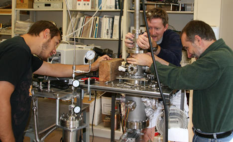 Matt Bovyn, left, NAU physics major and NASA Spacegrant intern, Stephen Tegler, center, professor of physics and astronomy and Will Grundy an astronomer from Lowell Observatory work with the ice chamber in the lab.