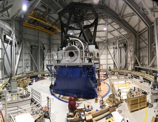 This photo shows a panoramic view of the interior of the Discovery Channel Telescope facility observing level. The mount is situated on a platform to allow for proper telescope positioning and pointing during active operations.
