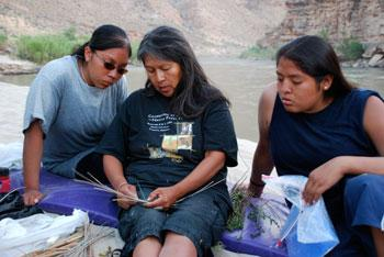 Ruby Chimerica demonstrates Hopi basket weaving to Saneil Honyaktewa (left) and Jalissa Albert on the San Juan River as part of the Hopi Footprints project.