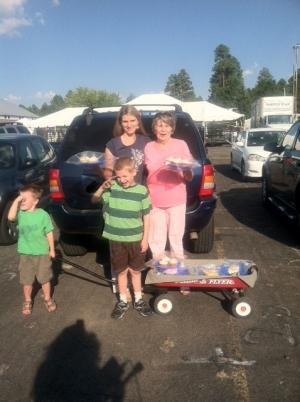 Laura and Lynda Locke, along with Ryland, 4, Warner, 8, and a red wagon full of goodies.