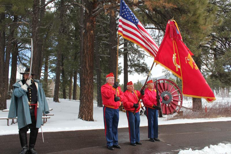 Members of Flagstaff's Marine Color Guard, from left, Pat Carr, Johnny Anaya,  and John H. Yazzie, honor Arizona's 100th birthday at the Pioneer Museum in Flagstaff, Tuesday, Feb. 14, 2012.