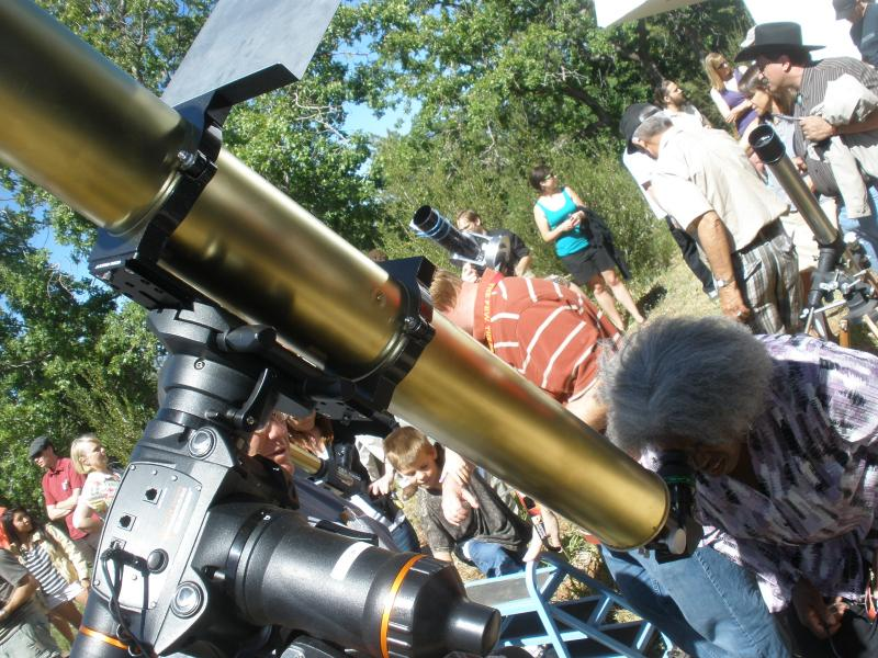 A sun-gazer views today's Venus transit through the Naval Observatory's historic Clark telescope. The instrument is the oldest telescope west of the Mississippi to have observed this the Venus transit over a century ago.