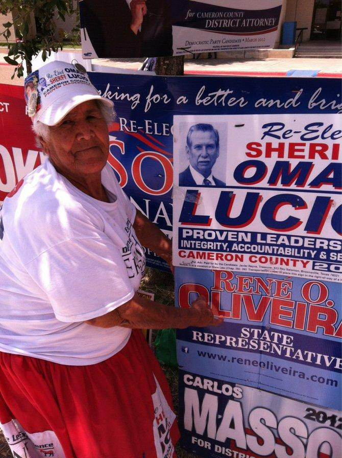 Herminia Becerra outside the Cameron County Courthouse in Brownsville, Texas, on an early voting day in May. She lives in Texas but was born in Mexico, and supports both Barack Obama and Andres Lopez Obrador.