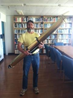 Mike Divittorio, telescope engineer at Flagstaff's US Naval Observatory, holds the famous Clark telescope which first viewed a Transit of Venus in 1874.