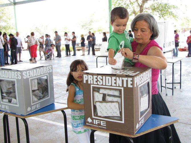 Patricia Terrazas casts her ballot for the Mexican presidential election in Ciudad Juárez. She is both a Mexican citizen and a U.S. resident who lives and works in El Paso, Texas.