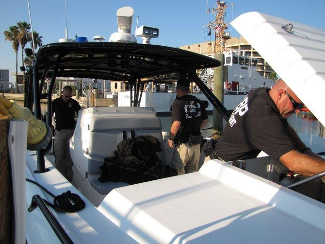 Homeland Security Marine Interdiction Agents prepare the boat to go out for a mission at Port Aransas, Texas.