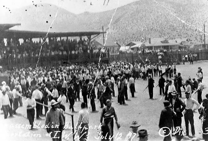 Deportation of striking miners from Bisbee, Arizona, on July 12, 1917. The miners and others who have been rounded up are assembled at Warren Ballpark and are sitting in the bleachers while armed members of the posse stand in the infield.