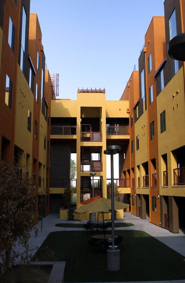 The courtyard of the energy-efficient Devine Legacy apartment building in Central Phoenix acts as a breezeway for the north-south facing complex.