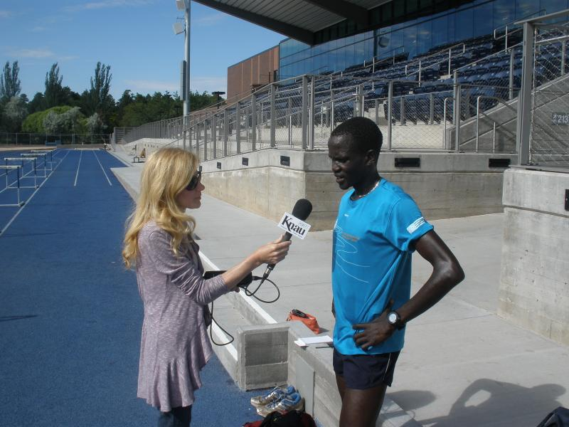Guor Marial speaking with KNAU'S Janice Baker at NAU track in Flagstaff, AZ