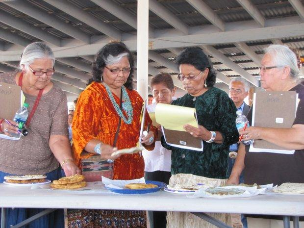 The judges taste the frybread.