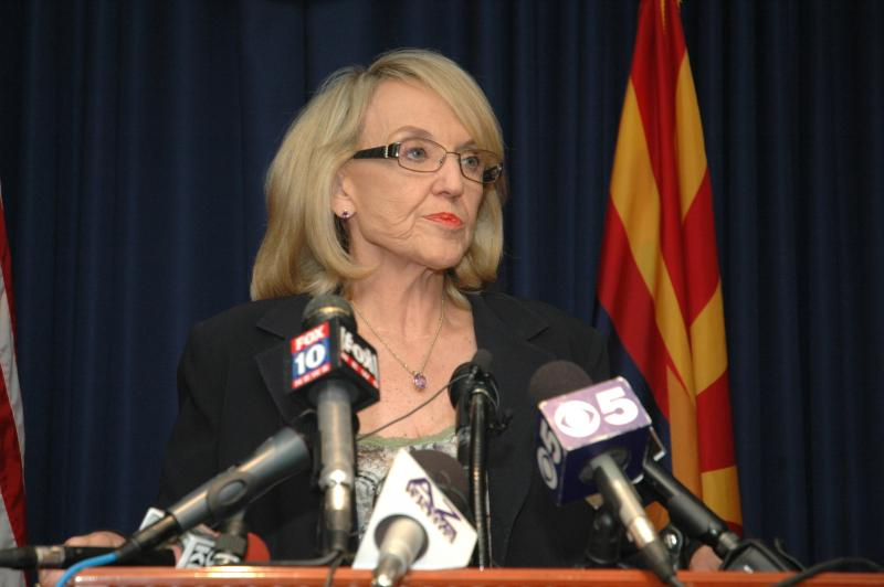 Gov. Jan Brewer reacts Wednesday to the refusal of U.S. District Court Judge Susan Bolton to issue a new injunction against a key provision of SB 1070.