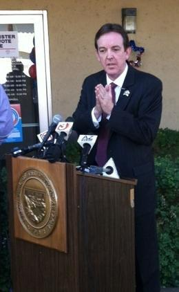Arizona Secretary of State Ken Bennett speaks at a press conference in Phoenix on National Voter Registration Day.