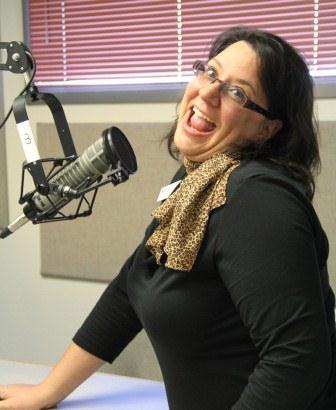 Development Director, Stacy Murison, in the studio keeping pledge drive interesting, recording a new ad.