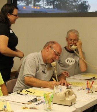 KNAU General Manager, John Stark, (center), enjoying some time taking pledge calls and talking to members during the final day of the drive.