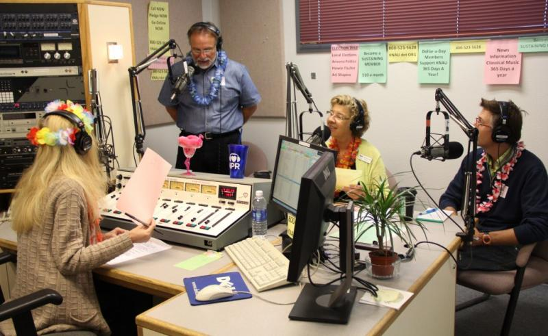 Early morning pitching, Hawaiian style, in studio 1. Pictured left to right are Morning Edition Host, Janice Baker, Bob Glazar, Karen Kinne-Herman, and guest Aaron Ells of Team Run Flagstaff.