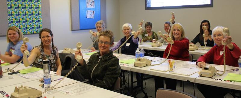 """Call me!""  -  Eager volunteers from The Arboretum at Flagstaff and Literacy Volunteers of Coconino County."
