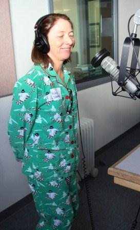 Phone volunteer Michelle Schaffer in-studio recording a KNAU Supporter testimonial