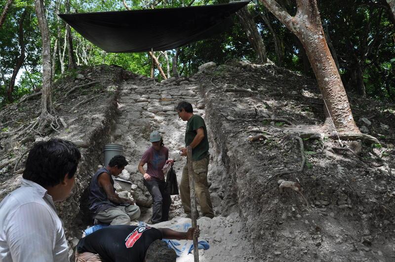 Jaime Awe (center) and graduate student Diane Slocum prepare to enter the tomb.