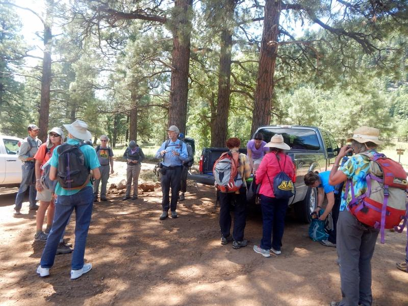 Larry Stevens speaks to volunteers during a training trip