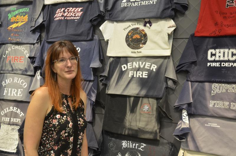 Katie Cornelius designed the T-shirt display. She works as curator for the Prescott Fire Department.