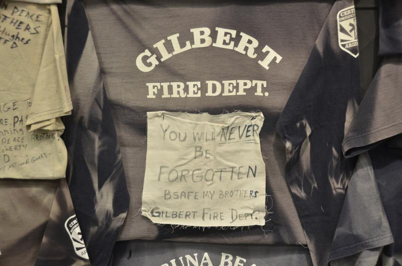 More than a thousand T-shirts from fire departments throughout the country were placed at a memorial on the fence surrounding the Granite Mountain Hotshots' station in the weeks following the tragedy.