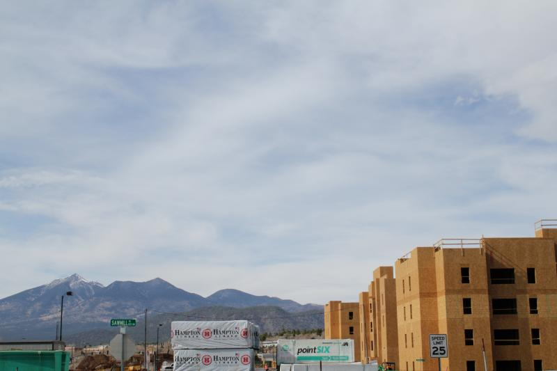 Construction has begun on a condominium complex south of Aspen Place. Candidates for mayor have differing views on what role the city should play in stimulating the economy.