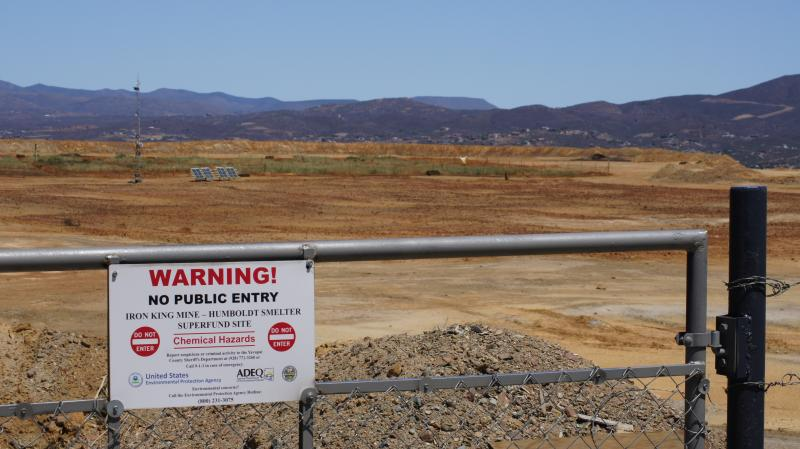 The view from near the entrance of Iron King Mine and the top of the tailings pile.  Mining equipment that used to be common to this site has now been replaced by scientific study equipment used by the EPA, ADEQ, and the University of Arizona.
