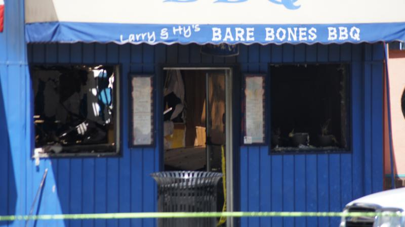 The investigators determined the fire started in the back of Larry Hy's BBQ.