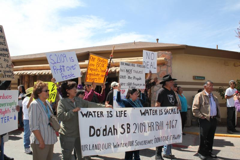 Protesters turned out to tell Sen. John McCain and Sen. Jon Kyl they do not support a water settlement bill in Tuba City, Thursday, April 5, 2012.