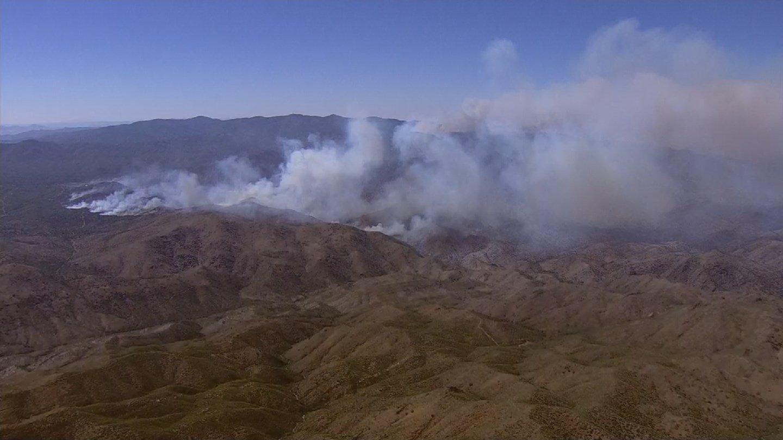 Some evacuees return to Arizona homes as fires sweep US West