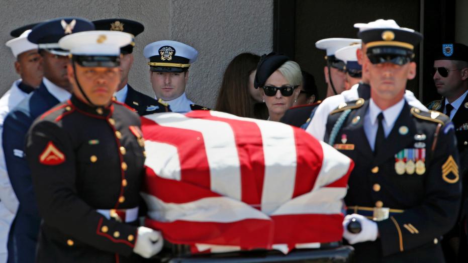 Obama, Bush mourn former rival McCain at Washington service