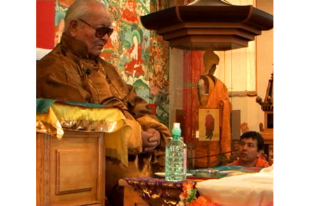 Chögyal Namkhai Norbu teaches while his son, Yeshi, looks on as Rinpoche gives teachings to thousands of local Kalmyks.