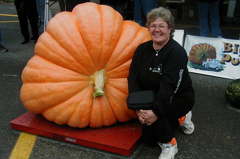 Competitor Deb Sundstrom with her oversized pumpkin.
