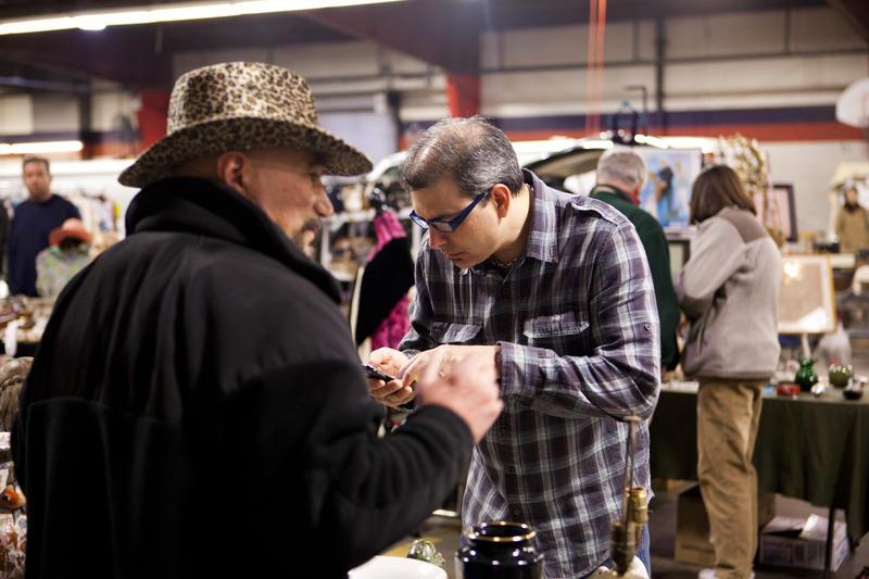 MARKET WARRIORS picker Kevin Bruneau negotiates with a vendor.