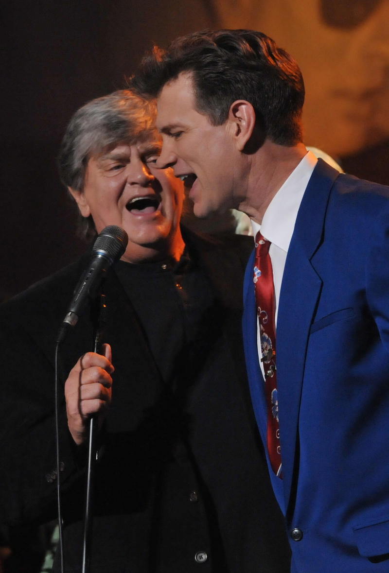 Phil Everly and Chris Isaak perform during the concert held at Hollywood's Music Box Theatre in celebration of what would have been Buddy Holly's 75th birthday, September 7, 2011.