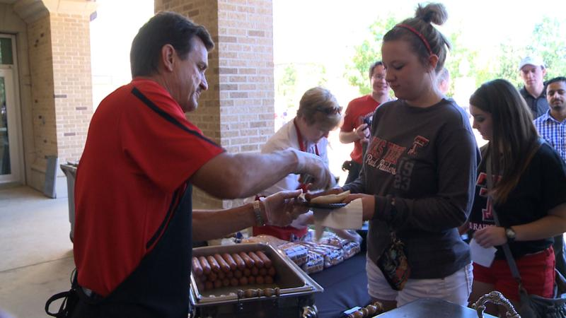 Interim President Dr. Lawrence Schovanec serves the Texas Tech community at the President's Welcome Picnic.