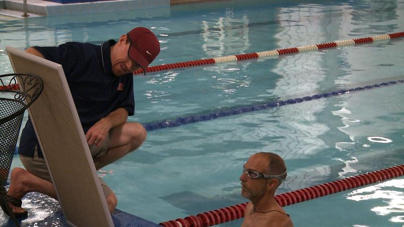 Lubbock Tri Club Coach Derek Kite coaches a swimmer.