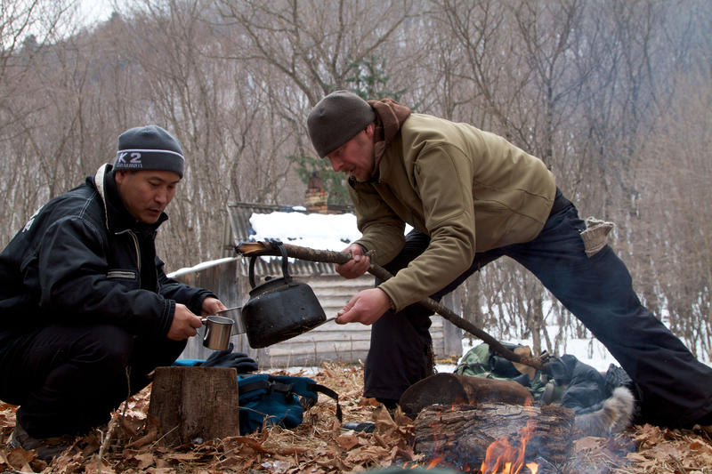 Meal times on the trail can be basic. Having to carry everything they will want during a day's hike Chris Morgan is seen here in tiger country, pouring a cup of tea for his companion, Korean film-maker Sooyong Park.