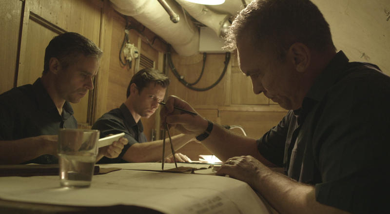 Dramatized scene of Soviet submarine B-59 crew meeting in the map room.