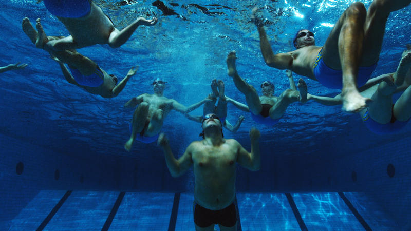 The team practices underwater.
