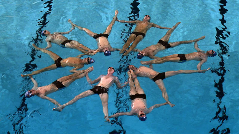 "Swimmers perform ""The Flower."""