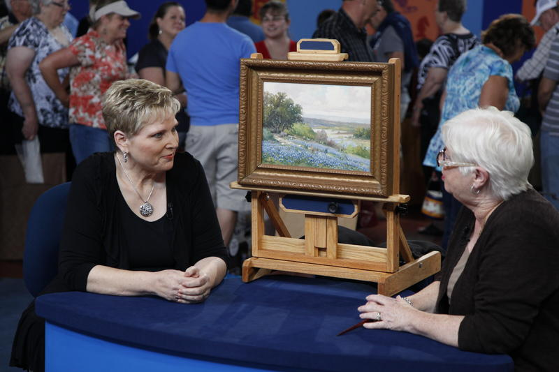 Appraiser Kathleen Harwood (right) with a Corpus Christi guest and her Porfirio Salinas painting.