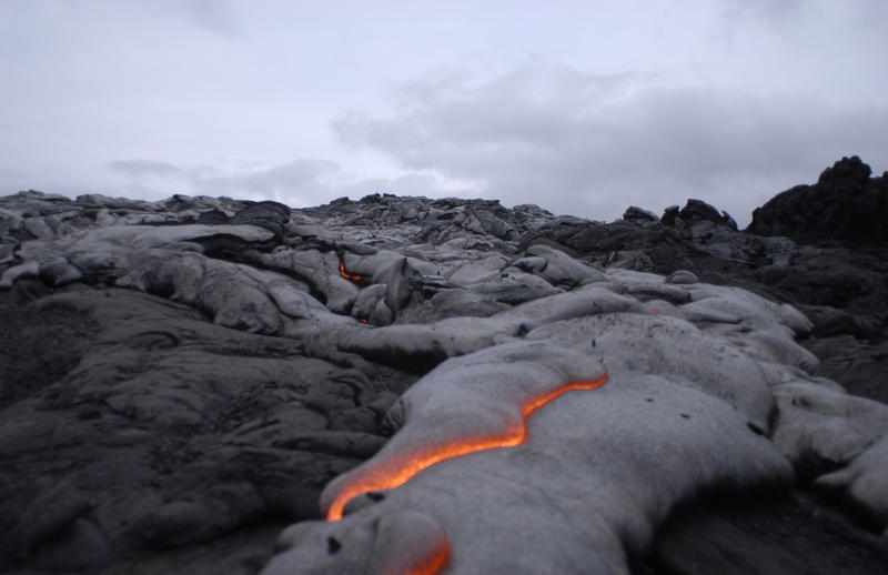 River of lava flowing into the sea, in Kilauea (Hawaii). When the liquid lava solidifies, it continues to build the volcano upwards.