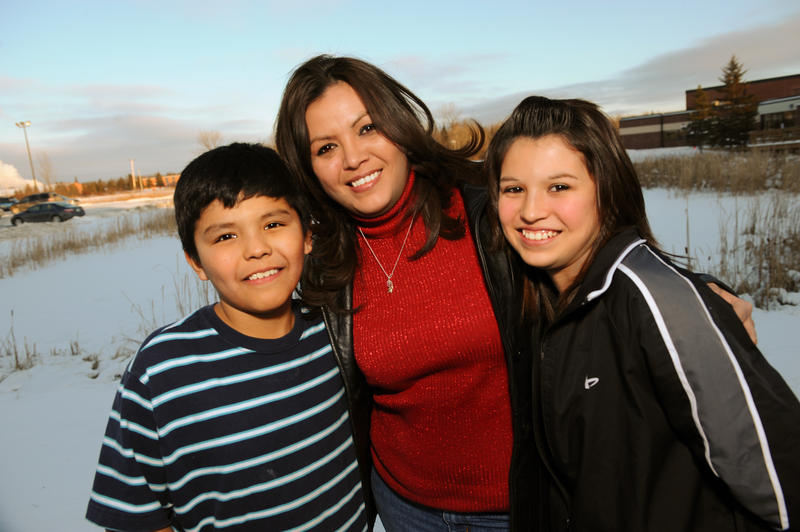 This series profiles Robin Charboneau (center), a 32-year-old divorced single mother and Oglala Sioux woman living on North Dakota's Spirit Lake Reservation, as she struggles to raise her children, Anthony (left) and Darian (right).